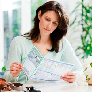 Woman reading bill