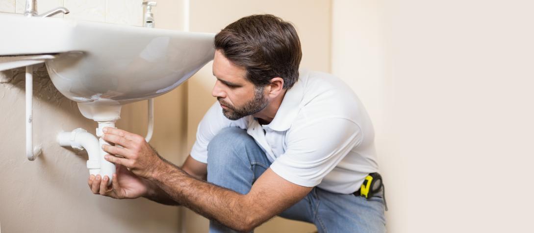 man installing basin